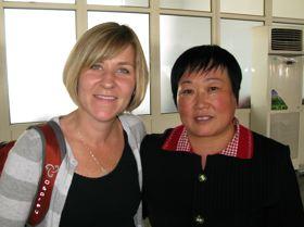 Kim z vodjo tovarne, Wang Weijing